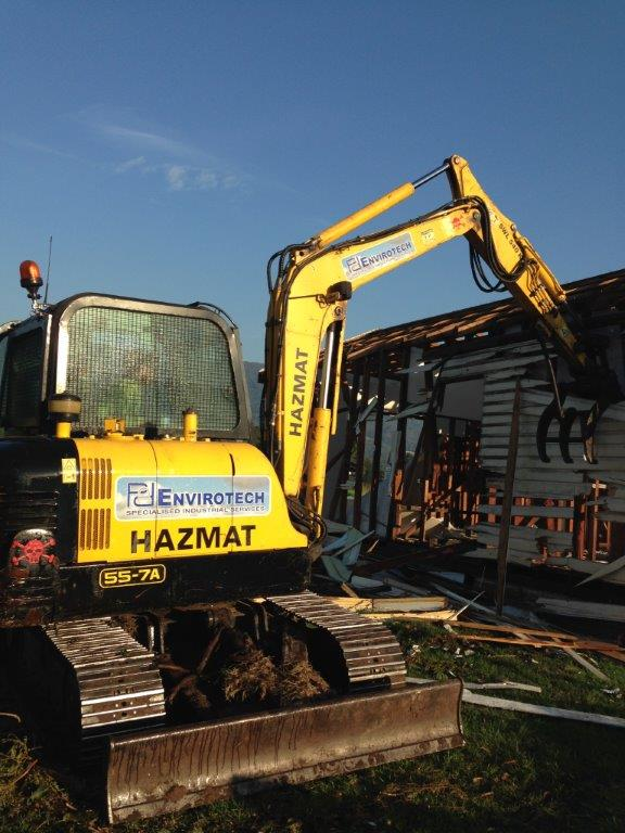 Excavator Dismantling A House