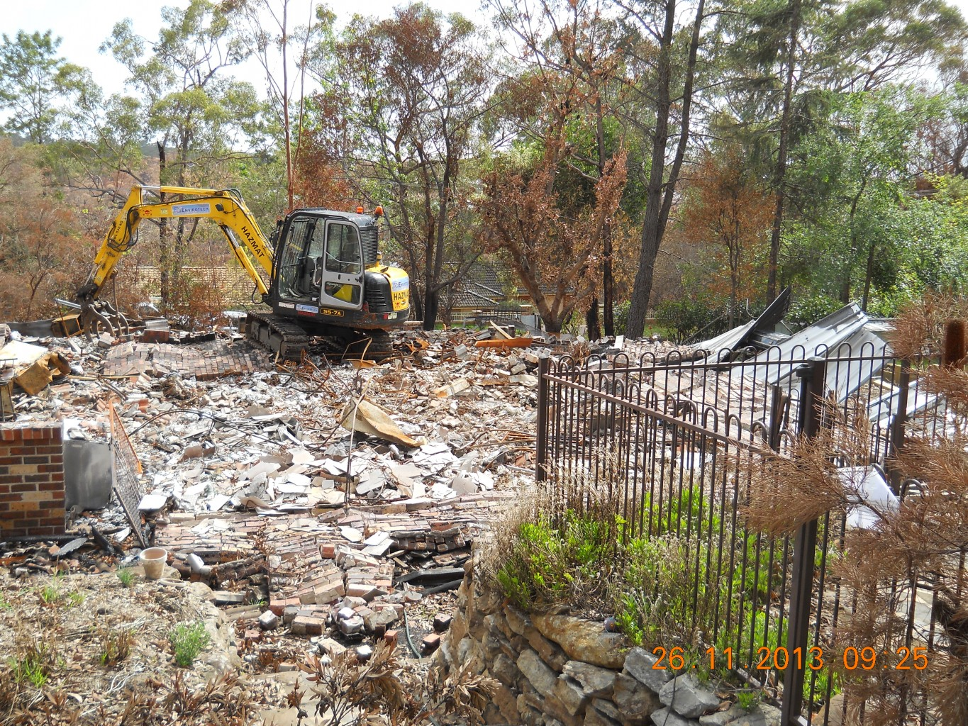 Excavator With Claw Moving Rubble And Debris
