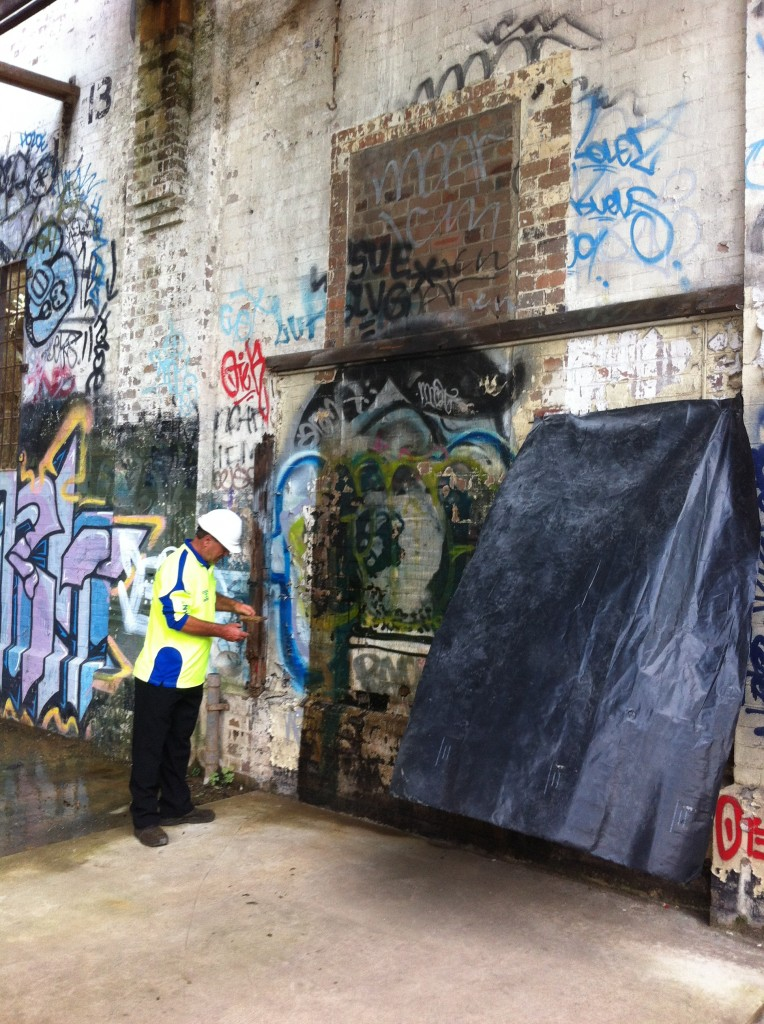 Inspecting A Grafitied Wall. Lead Paint Removal